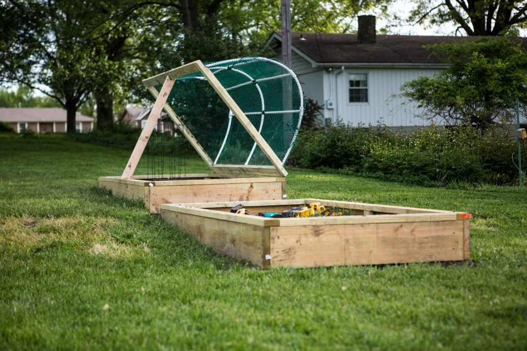 Raised Bed Garden Construction with Roof by Isaac Smith on Unsplash