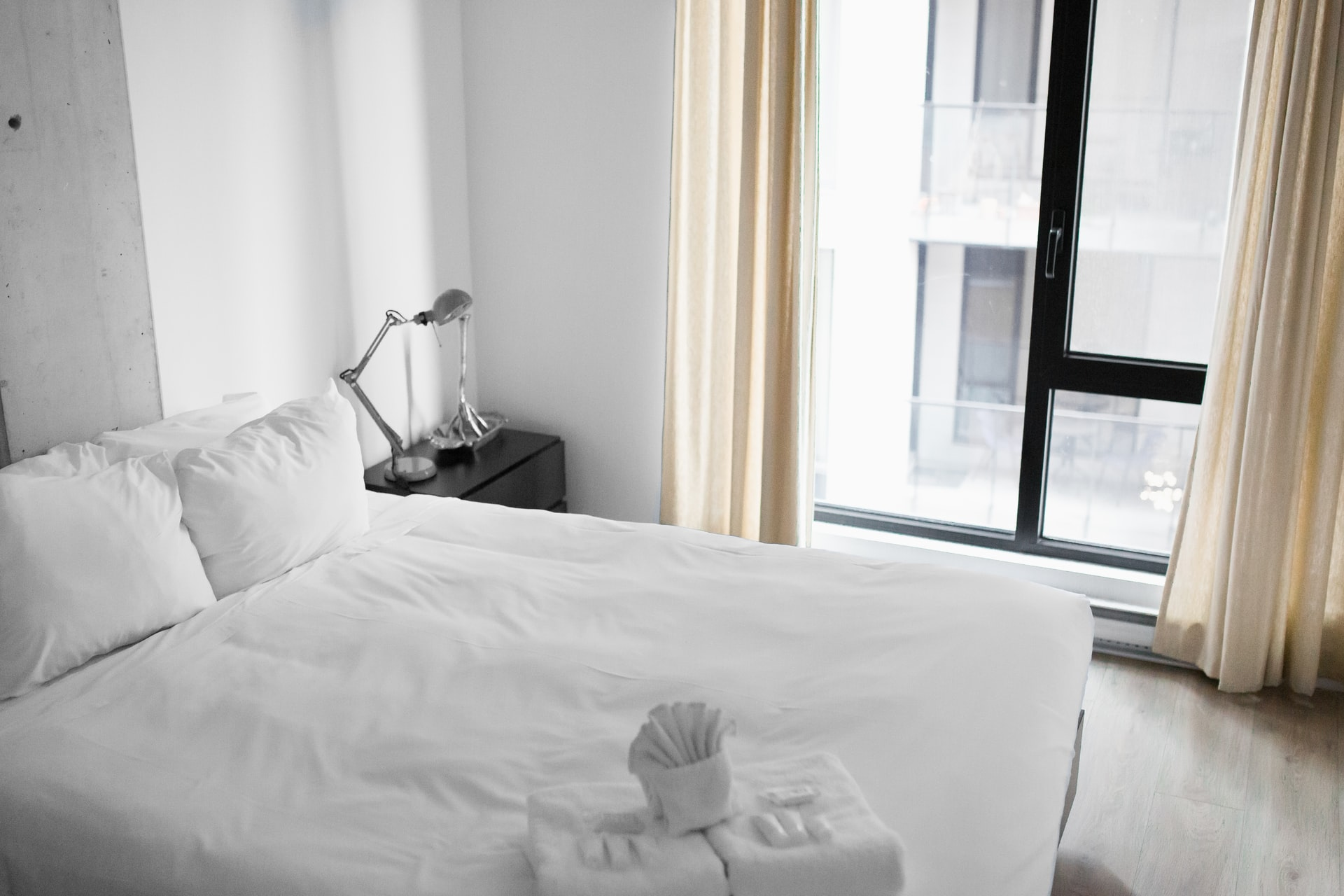 white bedroom with white comforter
