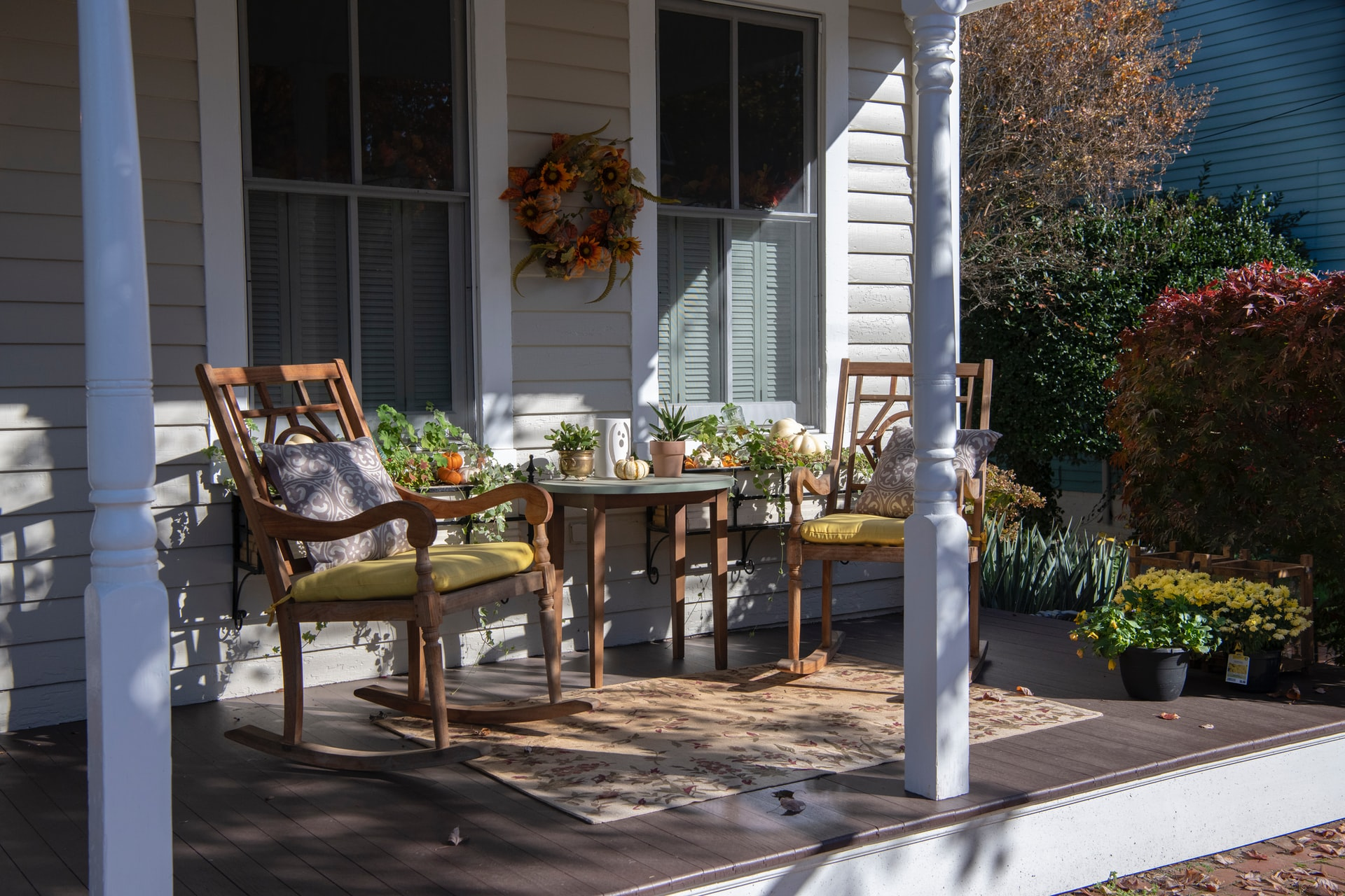 wooden patio furniture on front porch